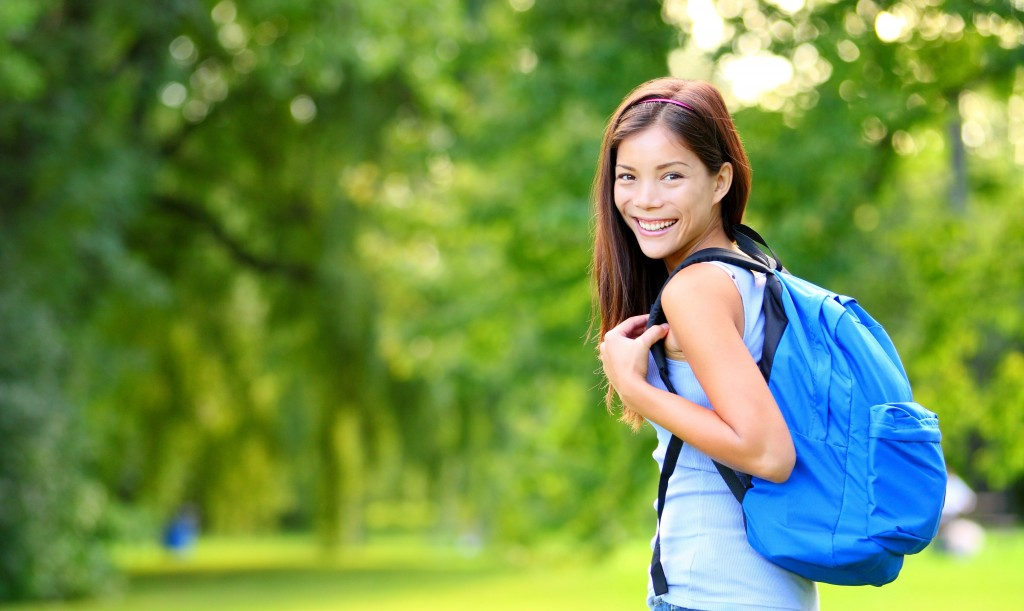 Student girl portrait wearing backpack outdoor in park smiling h